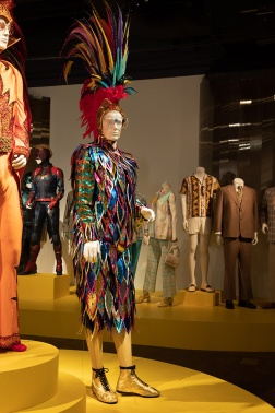"""""""Rocketman"""" costumes by Julian Day. These costumes can be seen in the 28th annual """"Art of Motion Picture Costume Design"""" exhibition, at the FIDM Museum, Fashion Institute of Design & Merchandising, Los Angeles. The exhibition is free to the public, Tuesday, February 4, through Saturday, March 21, 2020, 10:00 a.m. - 5:00 p.m. (L to R) Costumes worn by actor: Taron Egerton as Elton John (photo: Alex J. Berliner/ABImages)"""